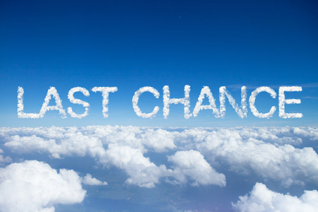 last minute: last chance clouds word on sky over clouds. Stock Photo