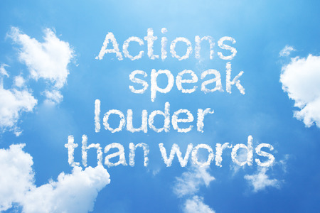 wriiting: Actions speak louder than words a cloud word on sky. Stock Photo