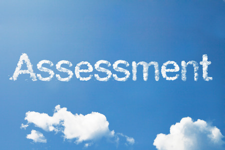 assessment: Assessment cloud word on sky Stock Photo