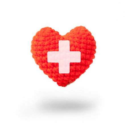recipient: Wool heart with cross sign