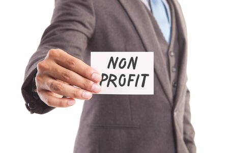non cash: Businessman hand showing someone his business card withnon profit message Stock Photo