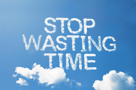 stop wasting time cloud word on sky in capital letters Stock Photo