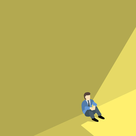 business man sitting alone against shadow wall with copyspace.