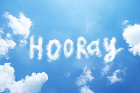 happiness or success: hooray cloud word on sky.