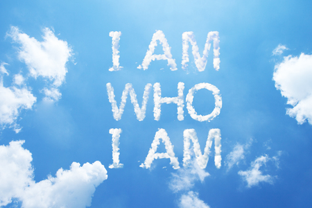 who: I am who  I am cloud word on sky. Stock Photo