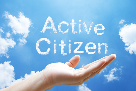 """Active Citizen"" cloud word floating on upturned hands."