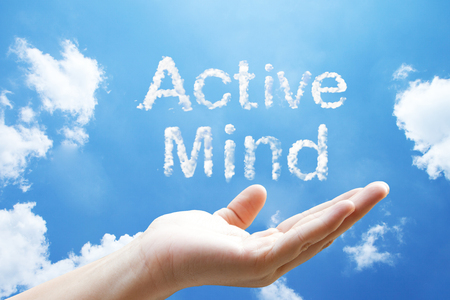 """Active Mind"" cloud word floating on upturned hands."