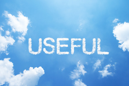 USEFUL cloud word on sky. Stock Photo