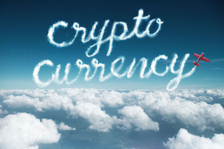 Crypto currency word created from a trail of smoke by Acrobatic plane.