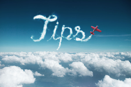 Tips word created from a trail of smoke by Acrobatic plane.
