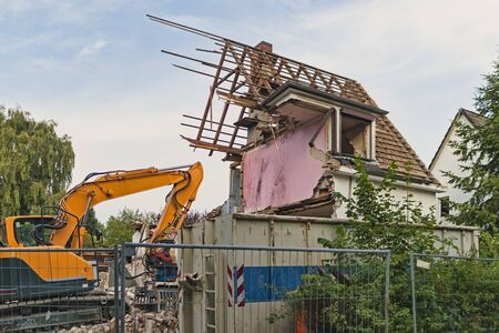 Ruined building and an excavator, germany, hamburg, 20.08.2012