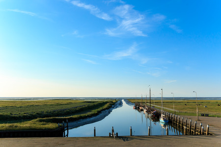 A very small sea harbour at the Wadden Sea  At the moment of this photo it photo