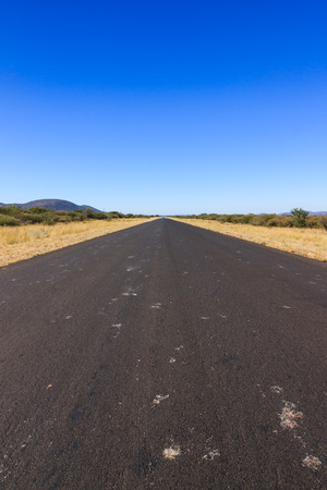 nowhere: Empty tar road to nowhere Namibia Africa.