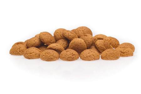 strooigoed: Several pepernoten, a typical dutch treat for Sinterklaas on 5 december. Cookie isolated on white background, front view.