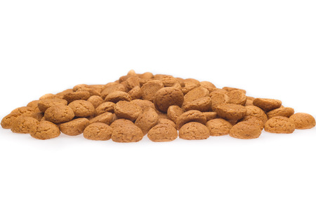 strooigoed: A lot of pepernoten, traditional dutch treat for Sinterklaas event on 5 december. Isolated on white background. Front view.