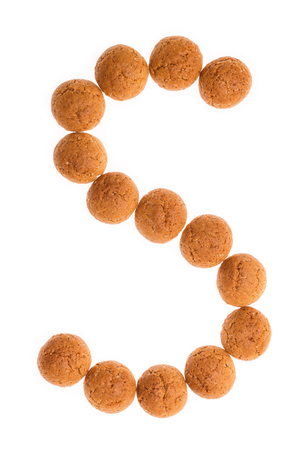 strooigoed: Character, letter S for Sint with pepernoten. A traditional dutch treat for Sinterklaas on 5 december. Cookies isolated on white background.