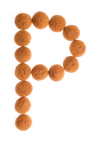 pepernoot: Character, letter P for Piet with pepernoten. A traditional dutch treat for Sinterklaas on 5 december. Cookies isolated on white background.