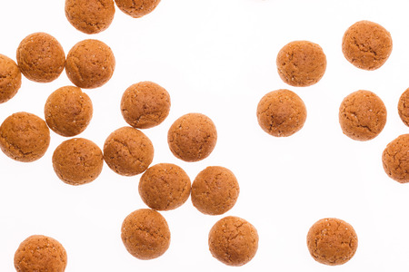 strooigoed: The dutch have a tradition of throwing pepernoten in their houses. A dutch treat for Sinterklaas holiday on 5 december. Isolated on white background. Stock Photo