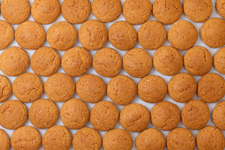 strooigoed: Pattern of pepernoten, ginger nuts. A dutch treat for Sinterklaas celebration on 5 december. Event in Holland, Netherlands. Stock Photo