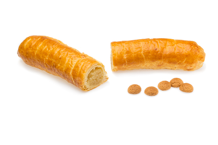 strooigoed: Banketstaaf and pepernoten dutch delicacy isolated on white background. Filled with almond paste eaten around Sinterklaas celebration on 5 december. Event in Holland, Netherlands and Belgium.