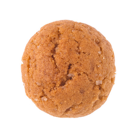 Single pepernoot close up. A traditional dutch treat for Sinterklaas on 5 december. Detailed cookie isolated on white background. photo