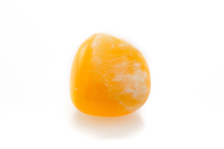 calcite: Bright orange calcite on a white background. Stock Photo