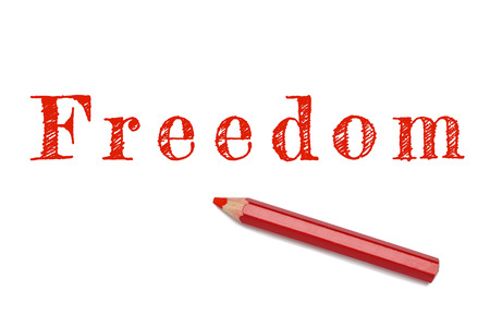 freedom of expression: Freedom written red pencil. Made after terrorism attack on Charlie Hebdo cartoonist newspaper Paris, France. Freedom of speech and expression.