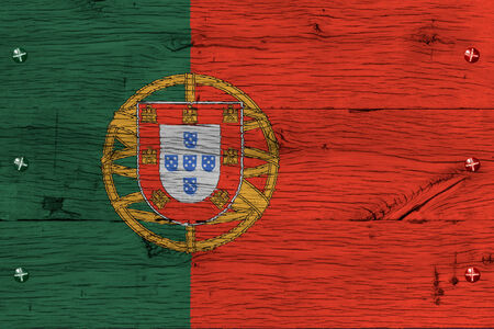 portugese: Portugal, Portugese national flag. Painting is colorful on wood of old train carriage. Fastened by screws or bolts.