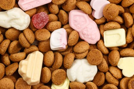 5 december: Background pepernoten and colorful sweets Sinterklaas. Typical food for Sinterklaas celebration on 5 december. Event in Holland, Netherlands and Belgium.