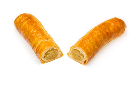 pepernoot: Banketstaaf two pieces dutch delicacy isolated white background. Foreground sharp gradually less sharp background. Food for Sinterklaas celebration on 5 december in Holland, Netherlands and Belgium.