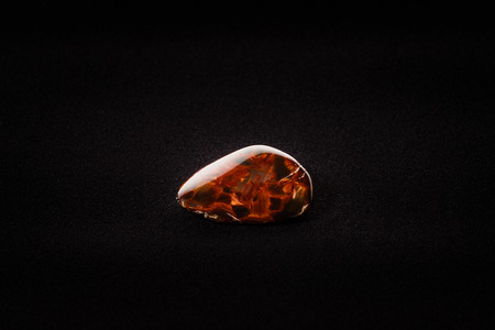 metamorphic: Piece of pietersite originating from Namibia Africa on velour fabric. Metamorphic gem stone type of tiger eye.
