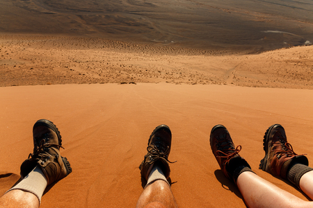 sand: Enjoying landscape and resting after climbing red sand dune in desert. Namibia, Sossusvlei, Naukluft, Africa.