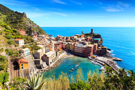 Vernazza famous fisherman village on steep cinque terre coast of Italy. Railroad track connects villages. Stock Photo