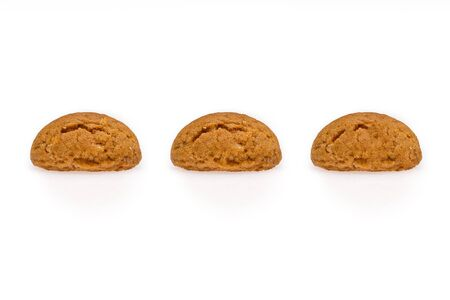 Three pepernoot, a typical dutch treat for Sinterklaas on 5 december. Cookies isolated on white background, front view.