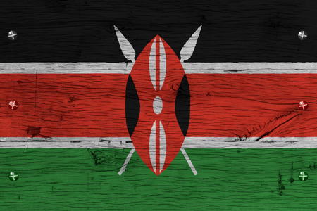 fastened: Kenya national flag painted on old oak wood. Painting is colorful on planks of train carriage. Fastened by screws or bolts.