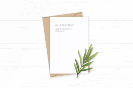 Flat lay top view elegant white composition letter kraft paper envelope tarragon leaf on wooden background. Vectores