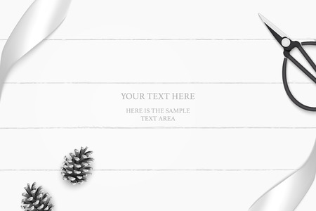 top view elegant white composition silver ribbon pine cone and vintage metal scissors on wooden floor background.