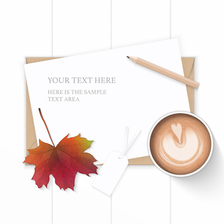 Flat lay top view elegant white composition paper kraft envelope tag autumn maple leaf pencil and coffee on wooden background.