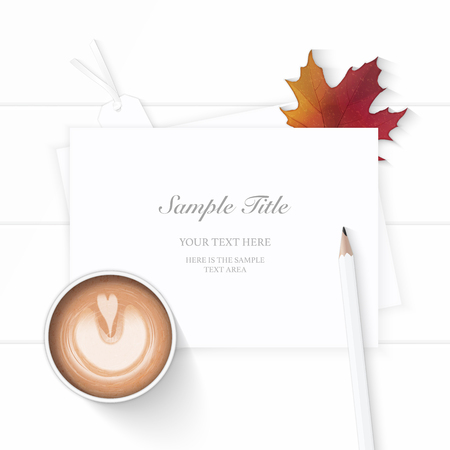 Flat lay top view elegant white composition paper autumn maple leaf tag coffee and pencil on wooden background.