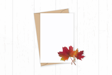 Flat lay top view elegant white composition letter, kraft paper envelope, autumn maple leaf on wooden background. Stock Photo