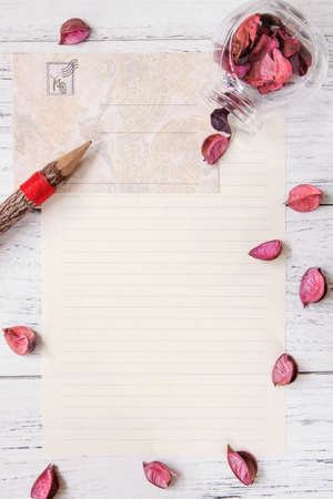 Flat lay stock photography purple flower petals letter envelope paper glass bottle wood pencil 写真素材