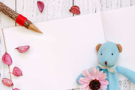 Stock Photography flat lay vintage white painted wood table purple flower petals bear doll pencil 写真素材
