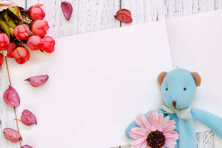 Stock Photography flat lay vintage white painted wood table purple flower petals bear doll rose
