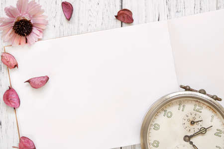 Stock Photography flat lay vintage white painted wood table purple flower petals vintage alarm clock 写真素材