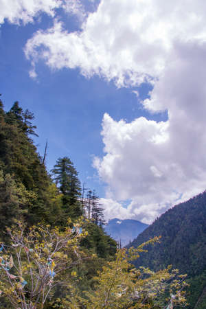 Mountain surrounded by cloud in sunny day landscape in Shangri La, Yunnan Province, China
