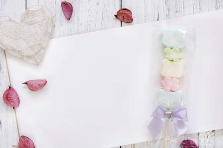 Stock Photography flat lay vintage white painted wood table note book paper flower petals cotton candy heart craft