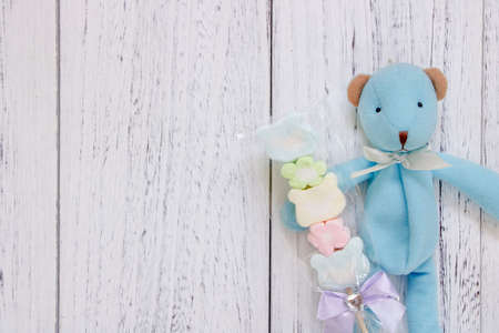 Stock Photography flat lay vintage white painted wood table blue bear doll holding cotton candy 写真素材