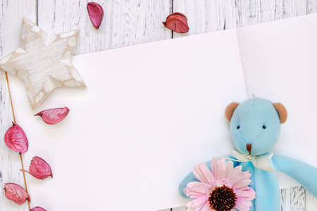 Stock Photography flat lay vintage white painted wood table purple flower petals bear doll star craft 写真素材