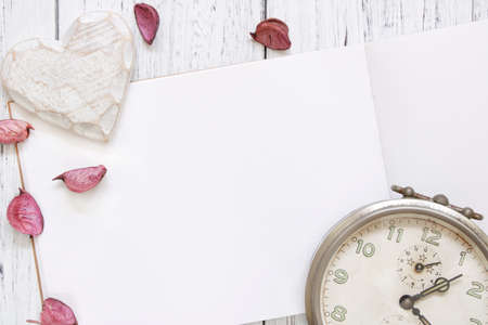 Stock Photography flat lay vintage white painted wood table purple flower petals vintage alarm clock heart craft 写真素材