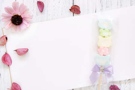 Stock Photography flat lay vintage white painted wood table note book paper purple flower petals cotton candy